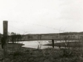 1968_Wesselerbrink_Vanaf_leemberg_gezicht_op_vijver_in_toek._park._Verte__industriehallen_aan_de_Buursestr._bron_Hans_Tietjens.JPG